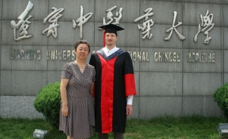 Dr.Zheng and I at the gates of the University